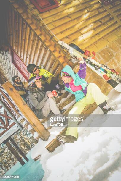 Four people taking selfie before skiing and snowboarding
