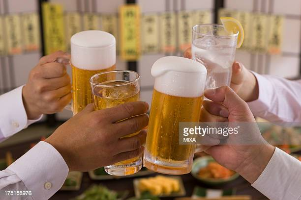 Four People Toasting with Beer and Chu-Hi at Izakaya