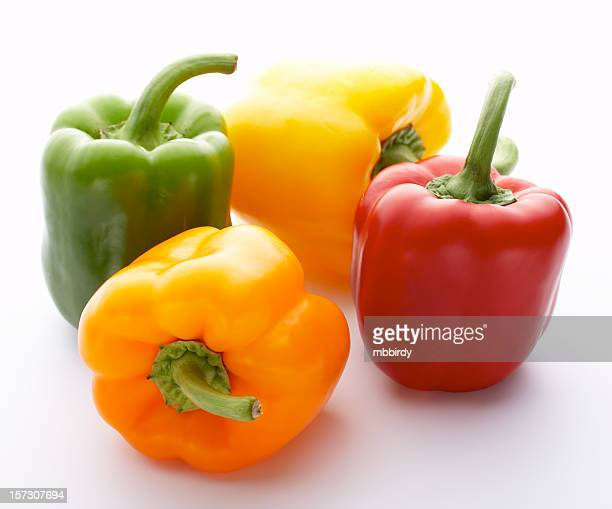 Four peppers, isolated on white background