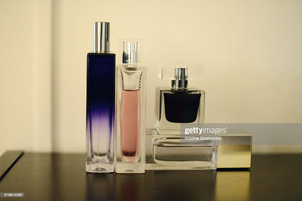 four perfume bottles : Stock Photo
