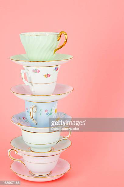 Four Pretty Old Fashioned Antique Teacups Stacked On Pink