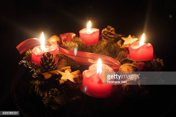 Four red candles in the dark