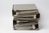 Four ring binders in a stack