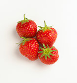 Four ripe strawberries