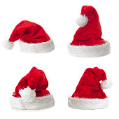 Four Santa Claus hat on white background.