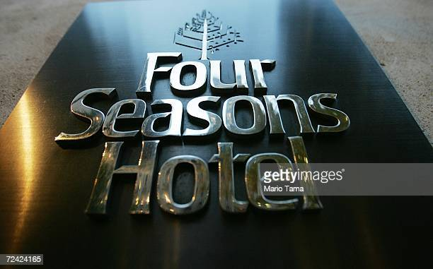Four Seasons Hotel sign is seen November 6 2006 in New York City The hotel chain has received a $37 billion buyout offer from a group including Bill...
