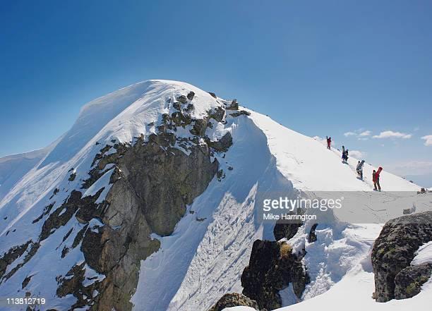 Four Skiers on Bansko Mountain
