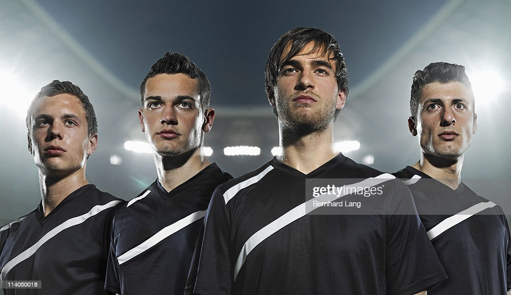 Four soccer players, close up