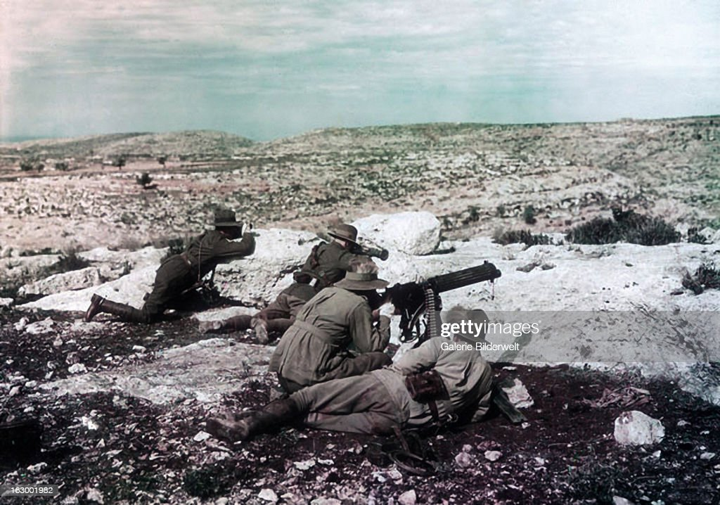 Four soldiers of the 3rd Australian Light Horse Regiment with machine gun in action near Khurbetha Ibn during the war against the Ottoman Empire...