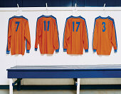 Four Sports Strips Hanging in a Changing Room