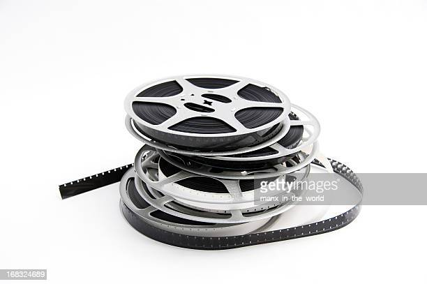 Four stacked film reels on white background