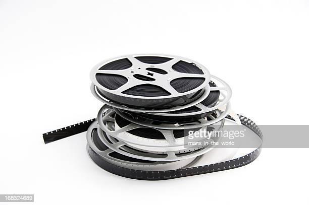 Vier liegen film reels auf weißem Hintergrund