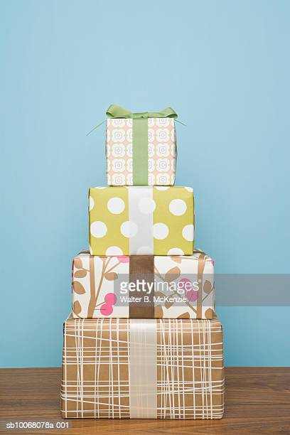 Four stacked gift wrapped boxes, studio shot