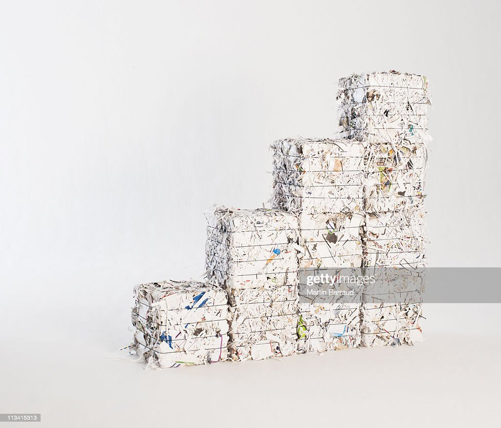 Four stacks of paper bales : Stock Photo