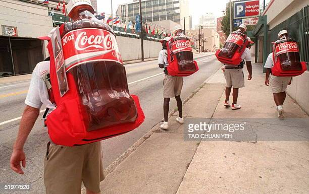 Four street vendors set off on a downtown Atlanta street to sell twoUSD Coca Cola cans from their portable backpack coolers 17 July Cocacola is an...