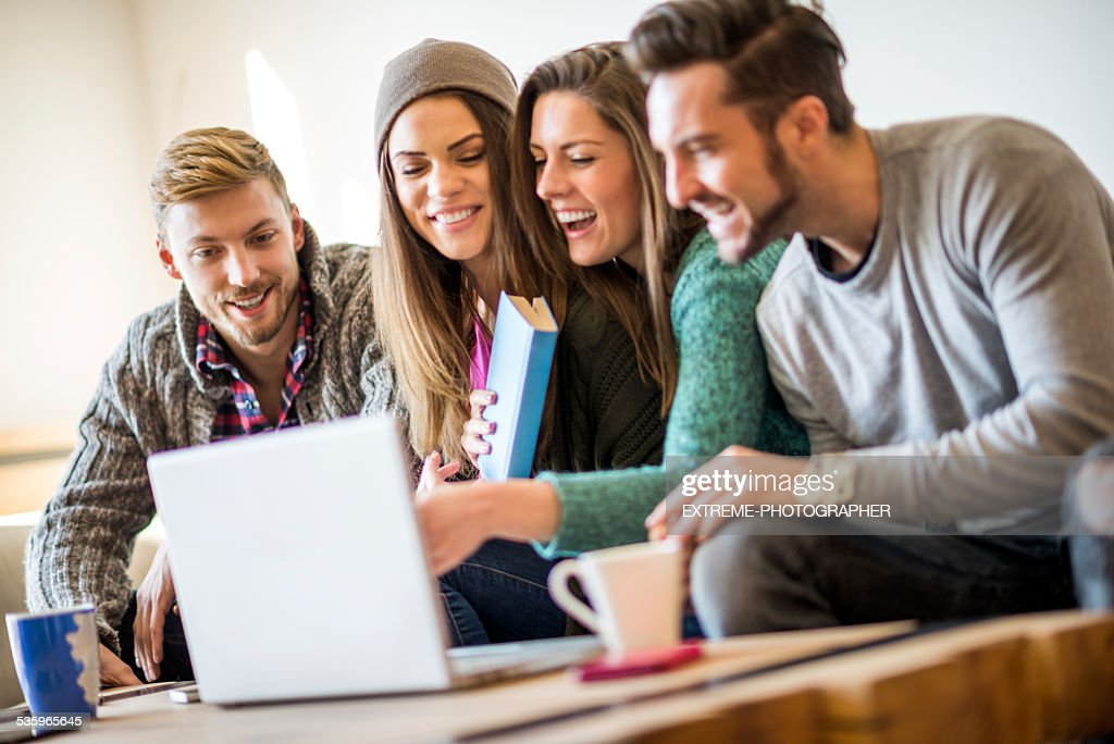 Four students learning together online : Stock Photo