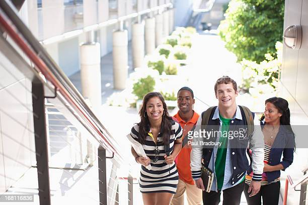 Four students on stairway