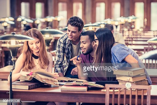 Four students studying and having fun