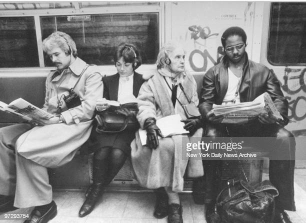 Four subway riders listening to their walkmans