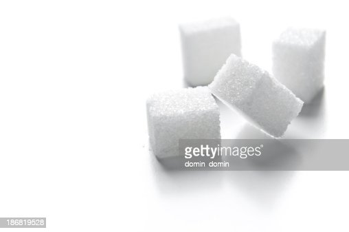 Four sugar cubes isolated on white