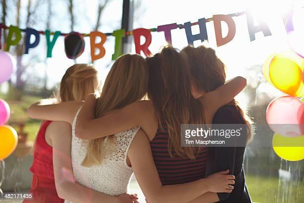 Four teenage girls celebrating birthday