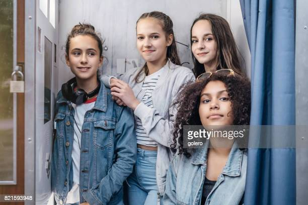four teenage girls in photoautomat