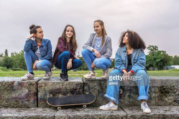 four teenage girls on stairs outdoors