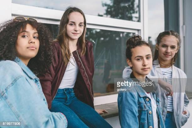 four teenage girls outdoors