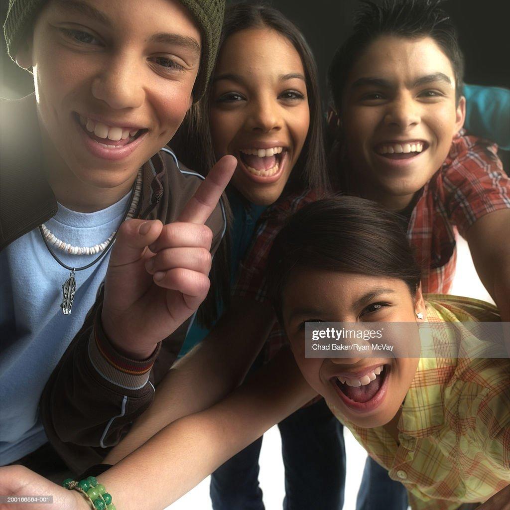 Four teenagers (13-15) smiling, portrait (Digital Enhancement)