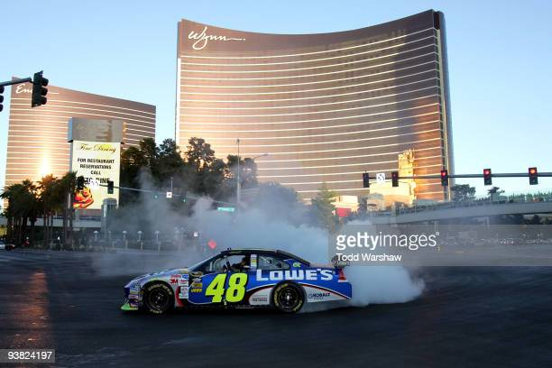 Four time NASCAR Sprint Cup Champion Jimmie Johnson driver of the Lowe's Chevrolet does a burnout in front of the Wynn Las Vegas during the Victory...