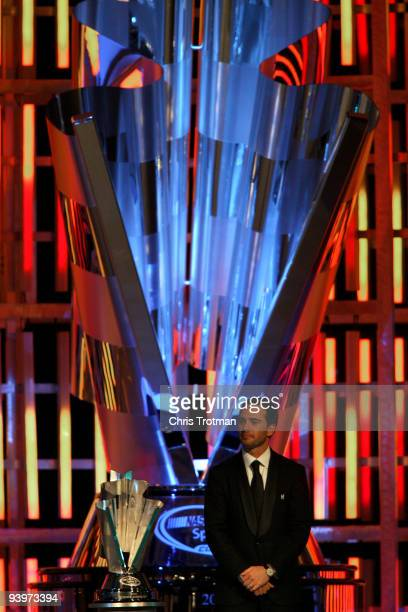 Four time NASCAR Sprint Cup Series Champion Jimmie Johnson stands on stage during the NASCAR Sprint Cup Series awards banquet during the final day of...