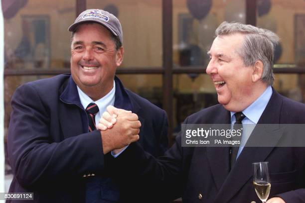 Four times America's Cup winner Dennis Connor from the New York Yacht Club shares a lighter moment with Peter Harrison the owner of Britain's...