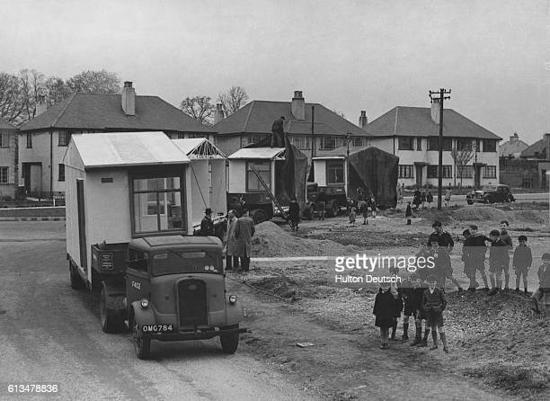 Four trucks each carrying a section of a prefabricated aluminium bungalow arrive at a site in Garrots Lane where 26 such homes are due to be...