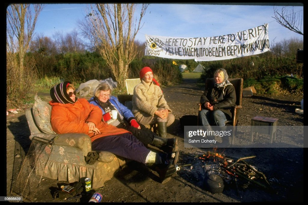 Four unidentifed female anti-nuclear weapons protestors demonstrating outside Greenham Common air base.