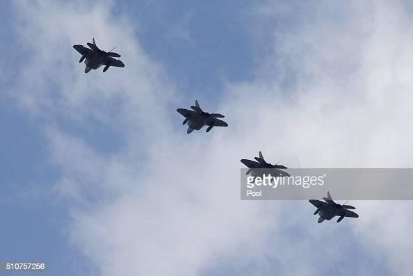 Four US F22 stealth fighters fly over Osan Air Base on February 17 2016 in Pyeongtaek South Korea US military has deployed four F22 stealth fighter...