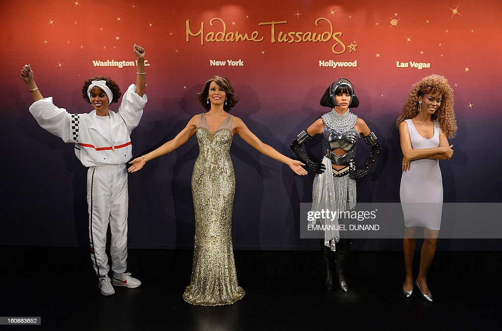 Four wax figures of late US singer Whitney Houston are unveiled at Madame Tussauds New York on February 7, 2013. The new wax likenesses, representing Houston in four different points of her life, were unveiled in front of some of her family members before being individually installed in each of the four US-based Madame Tussauds attractions in New York, Washington DC, Los Angeles and Las vegas. AFP PHOTO/Emmanuel Dunand