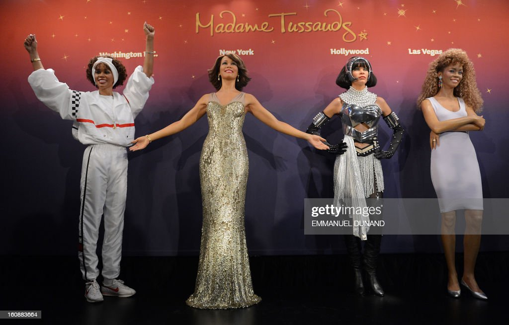Four wax figures of late US singer Whitney Houston are unveiled at Madame Tussauds New York, February 7, 2013. The new wax likenesses, representing Houston in four different points of her life, were unveiled in front of some of her family members before being individually installed in each of the four US-based Madame Tussauds attractions in New York, Washington DC, Los Angeles and Las vegas. AFP PHOTO/Emmanuel Dunand