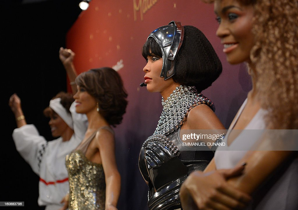 Four wax figures of late US singer Whitney Houston are unveiled at Madame Tussauds in New York, February 7, 2013. The new wax likenesses, representing Houston in four different points of her life, were unveiled in front of some of her family members before being individually installed in each of the four US-based Madame Tussauds attractions in New York, Washington DC, Los Angeles and Las vegas. AFP PHOTO/Emmanuel Dunand