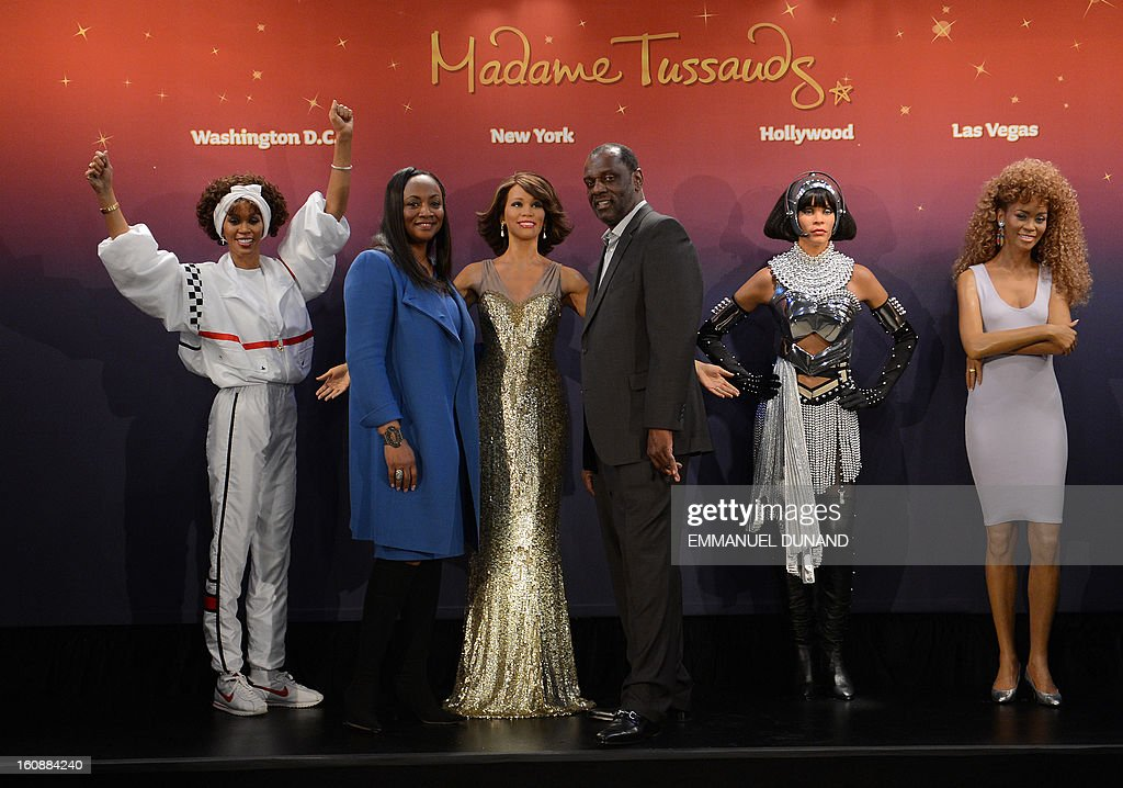 Four wax figures of late US singer Whitney Houston are unveiled at Madame Tussauds New York in presence of her brother Gary (Center R) and his wife Pat, in New York, February 7, 2013. The new wax likenesses, representing Houston in four different points of her life, were unveiled in front of some of her family members before being individually installed in each of the four US-based Madame Tussauds attractions in New York, Washington DC, Los Angeles and Las vegas. AFP PHOTO/Emmanuel Dunand
