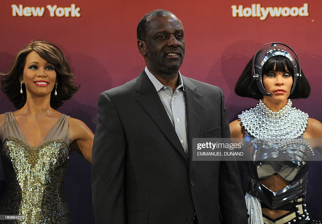 Four wax figures of late US singer Whitney Houston are unveiled at Madame Tussauds New York in presence of her brother Gary (C), in New York, February 7, 2013. The new wax likenesses, representing Houston in four different points of her life, were unveiled in front of some of her family members before being individually installed in each of the four US-based Madame Tussauds attractions in New York, Washington DC, Los Angeles and Las vegas. AFP PHOTO/Emmanuel Dunand