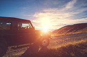 Four Wheel drive on Mountain at Sunset with