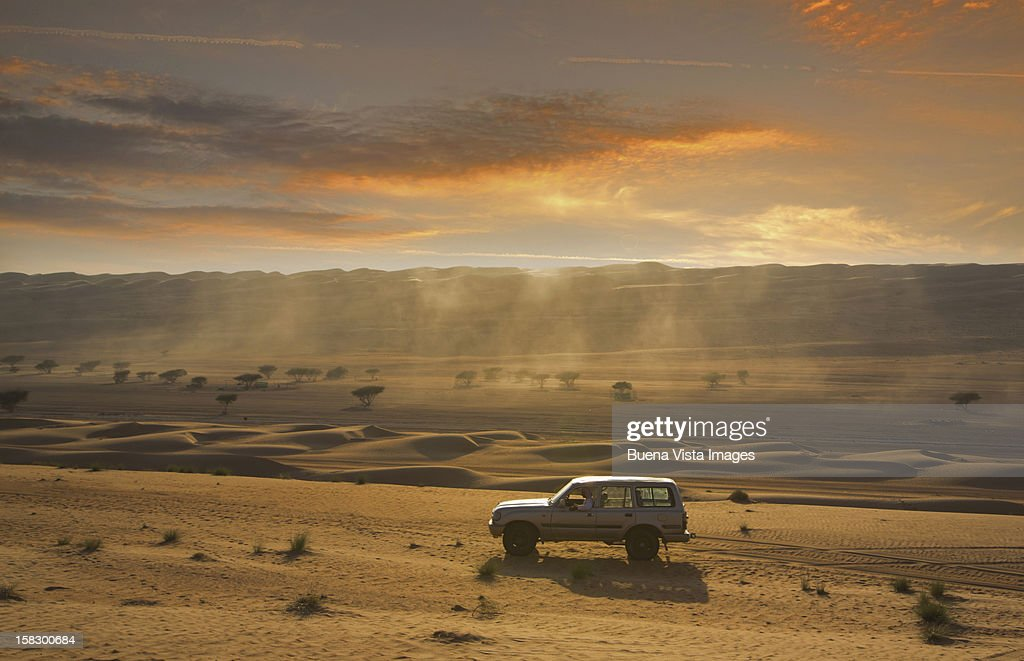 Four wheel driving in a desert : Stock Photo