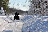A four wheeler attempts to make his way through nearly five feet of snow on November 19 2014 in the Lakeview neighborhood of Buffalo New York The...