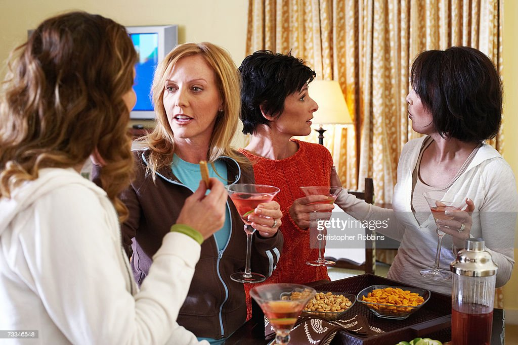 Four women chatting over cocktails and appetizers
