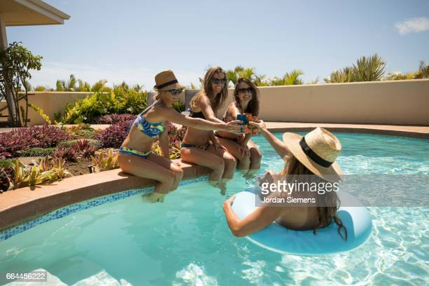 Four women in a swimming pool.