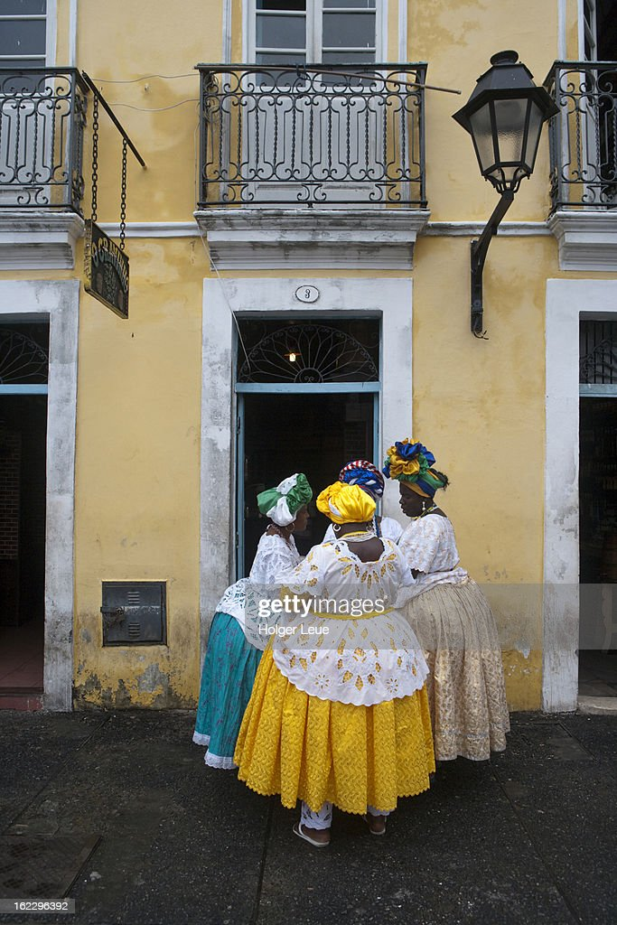 Four women in traditional costume in old town