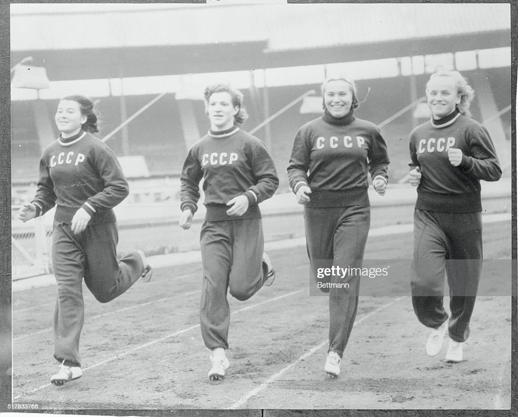 Four women member of the 70 strong Russian team are shown working out around the track at London's White City as they tuned up for the London versus...