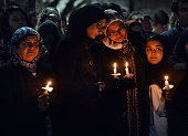 Four women pay their respects during a vigil for murder victims Deah Barakat his wife Yusor AbuSalha and AbuSalha's sister Razan AbuSalha on...