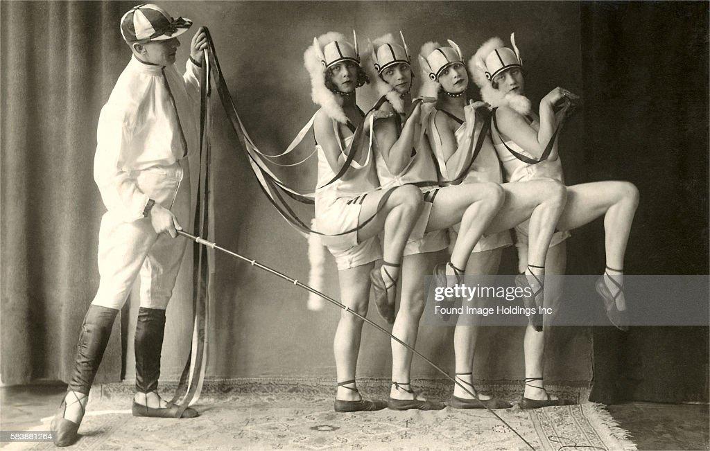 Four Women Posing as Horses