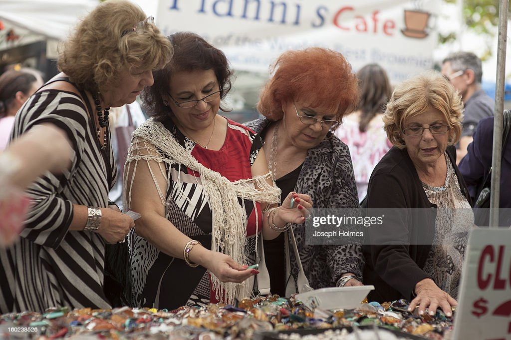 CONTENT] Four women shop for earrings at a stall in New York City's San Gennaro street festival in September 2011. Officially known as The Feast of San Gennaro, the multi-block street fair is held annually in the fall in Manhattan's Little Italy district.